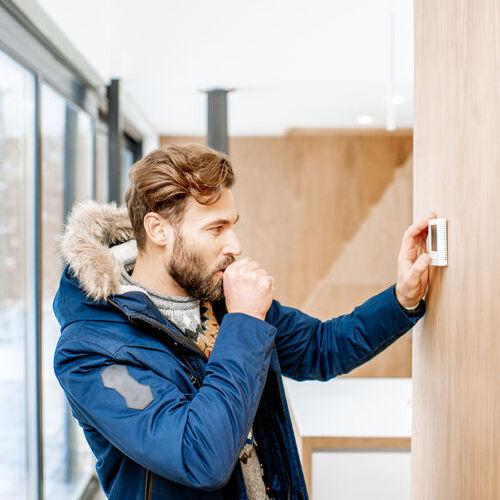 man adjusting temperature