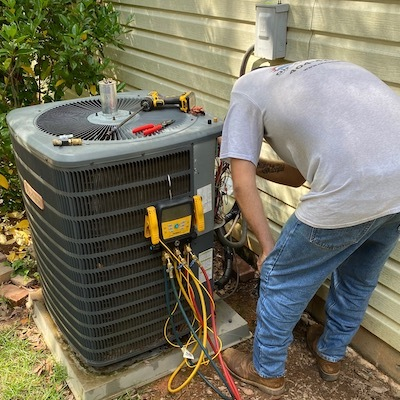 HVAC repairman replacing a capacitor